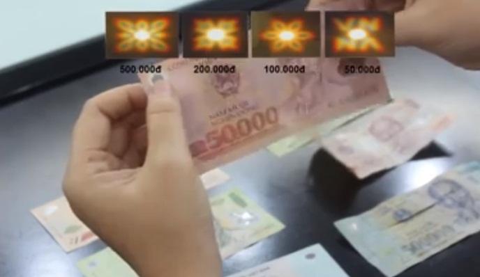 Cách phân biệt tiền giả với tiền thật